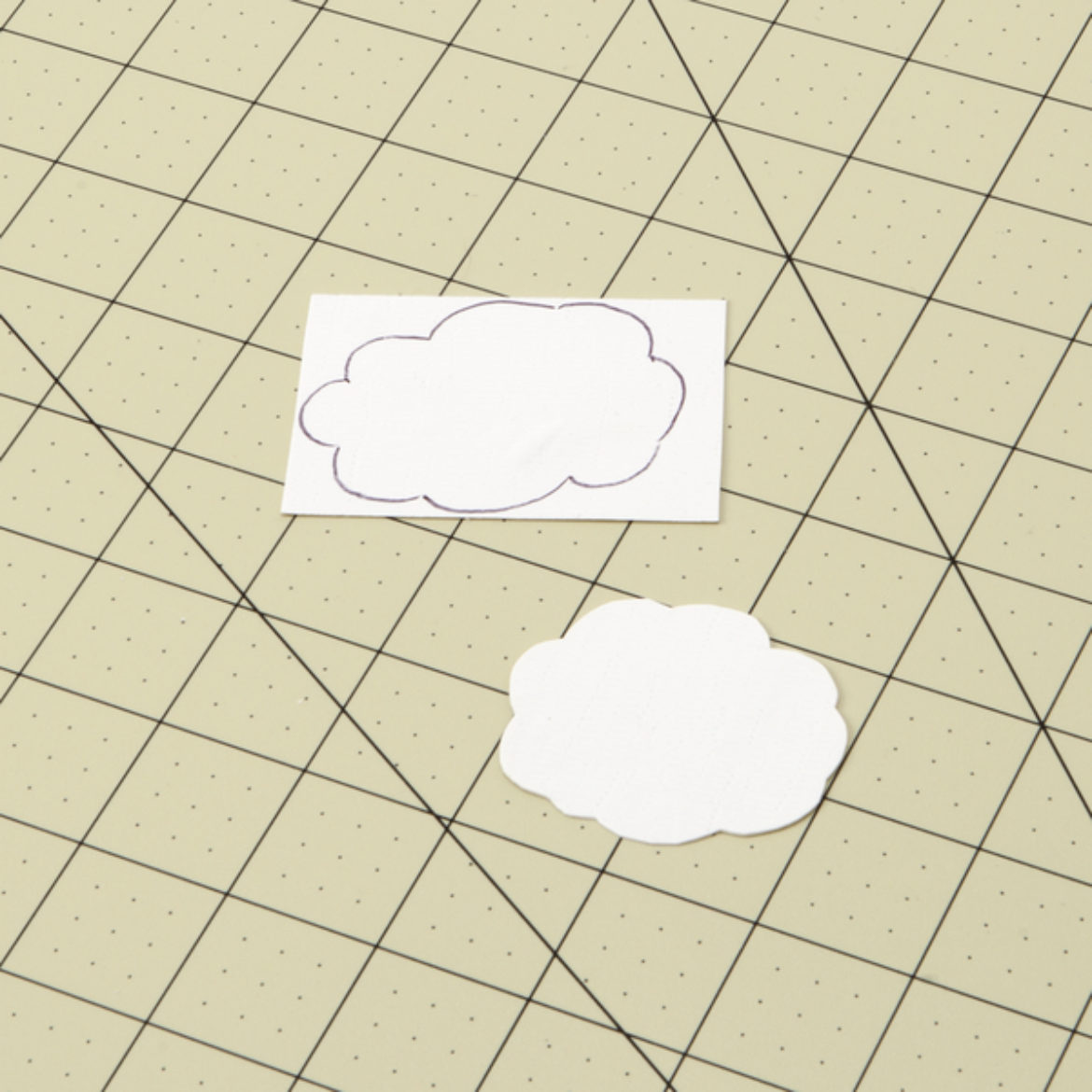 Cloud shape drawn onto and cut out of a piece of white Duck Tape fabric