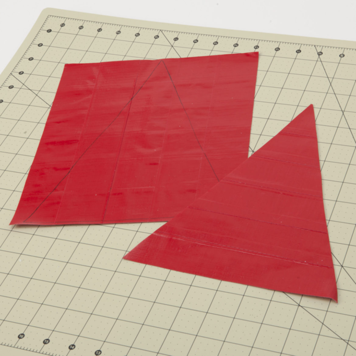Draw and cut out a large triangle from the fabric from the last step