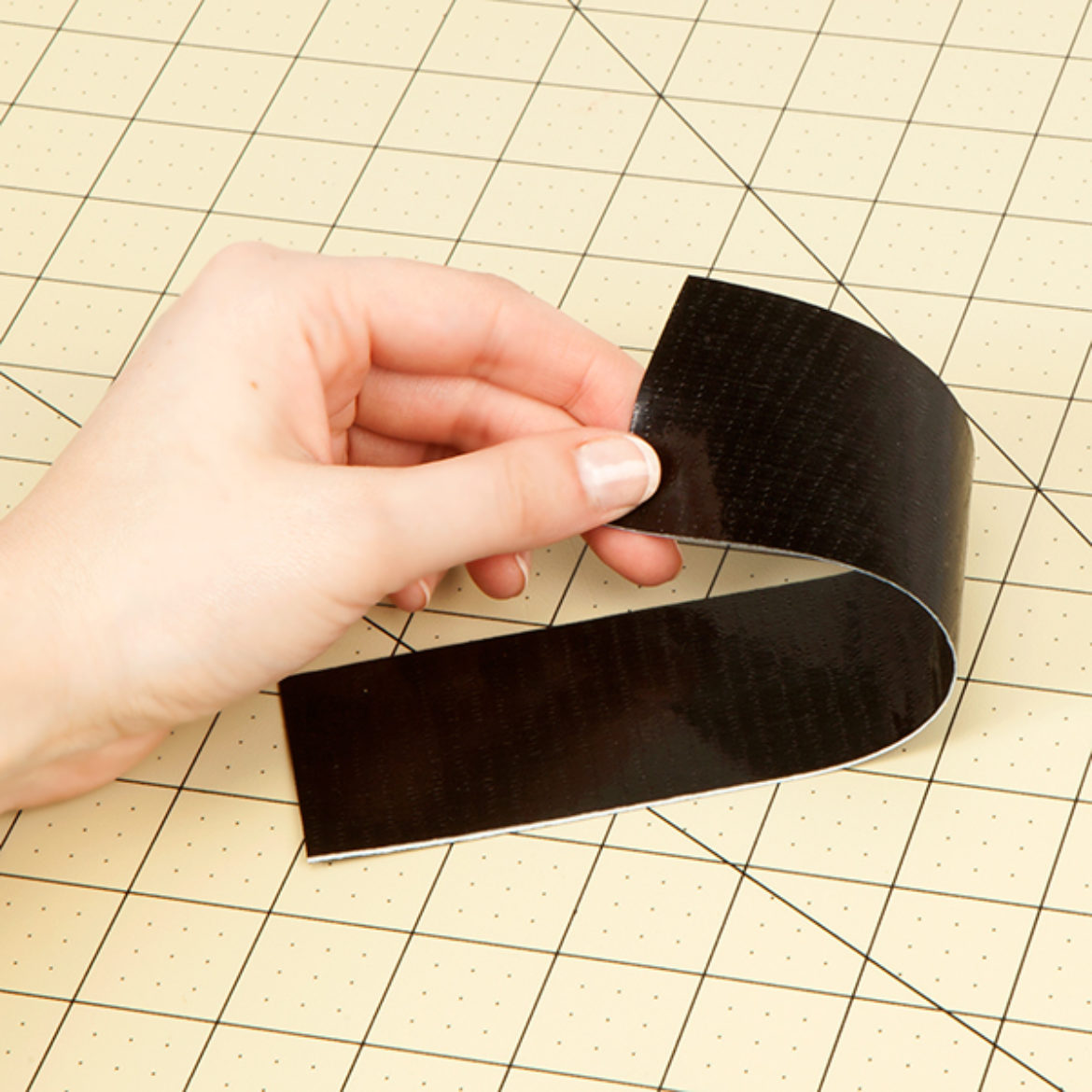 Double sided strip of Duck Tape created by folding a piece of tape over itself