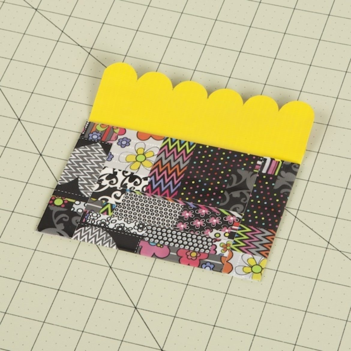 Tape placed over the open sides of the folded Duck Tape fabric to create the pocket