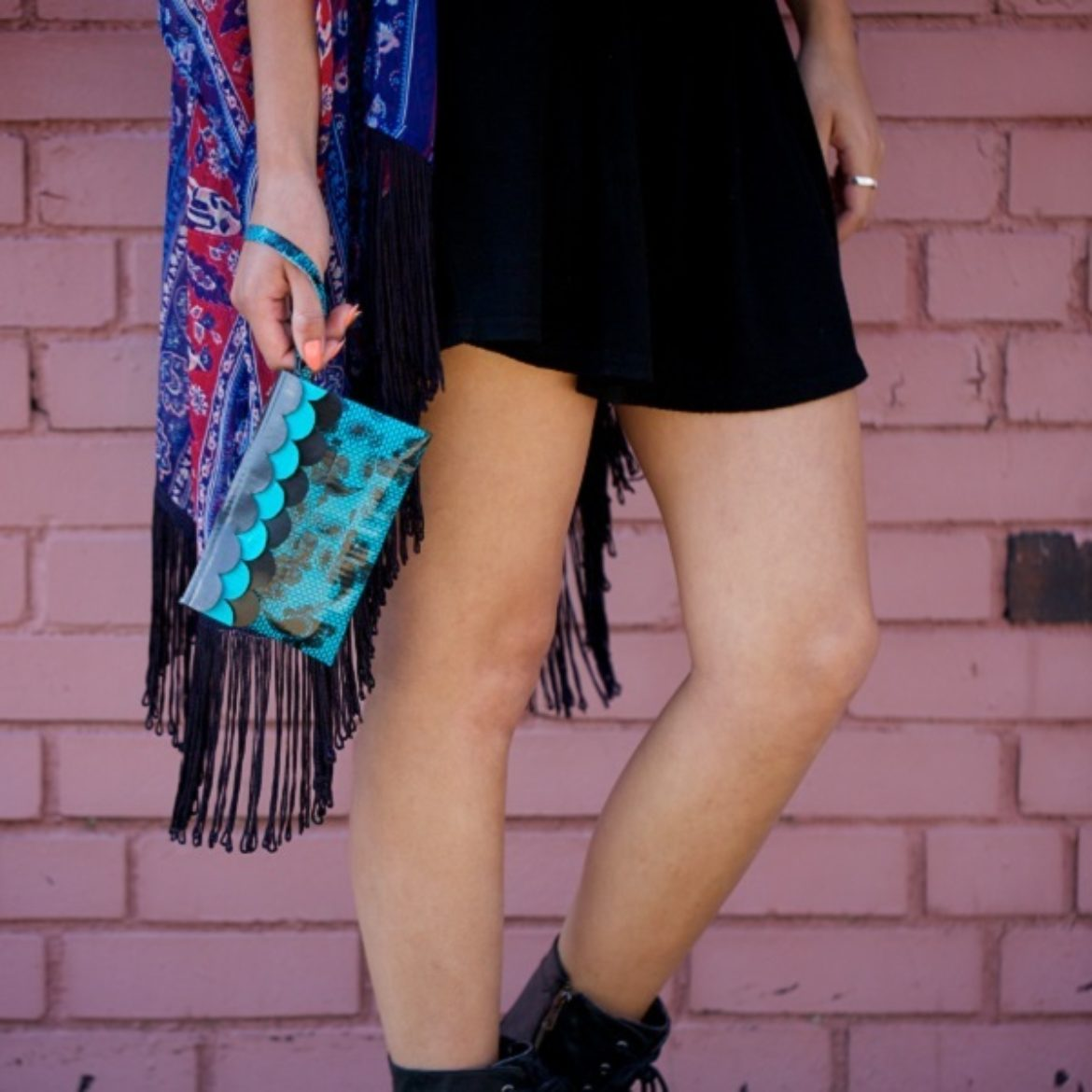 Woman holding a completed Duck Tape Scalloped Wristlet
