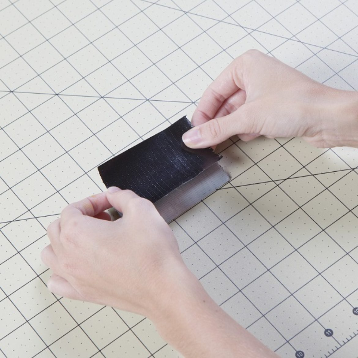 Double sided strip of black Duck Tape