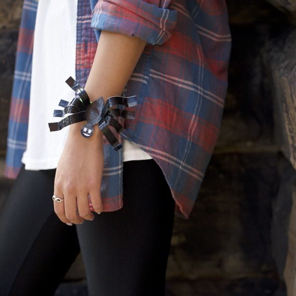 Woman wearing a completed Duck Tape® Spider Bracelet