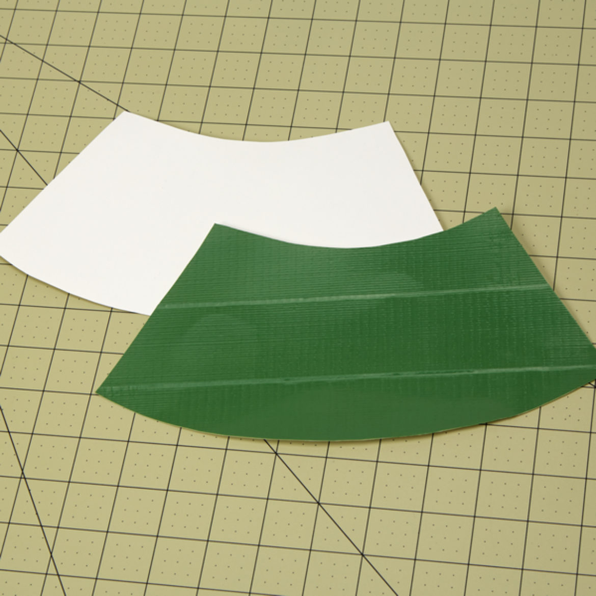 Arch shape cut out of a piece of poster board, then covered in green Duck Tape