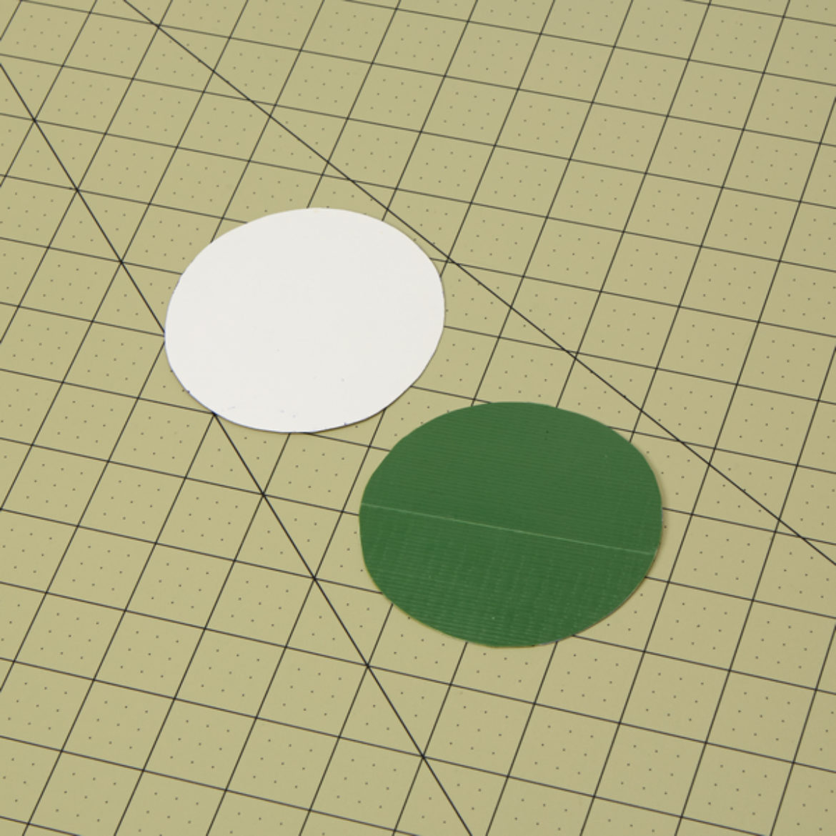 Circles in the same shape and sze as the opening of the larger side of the flared cylinder from the previous step