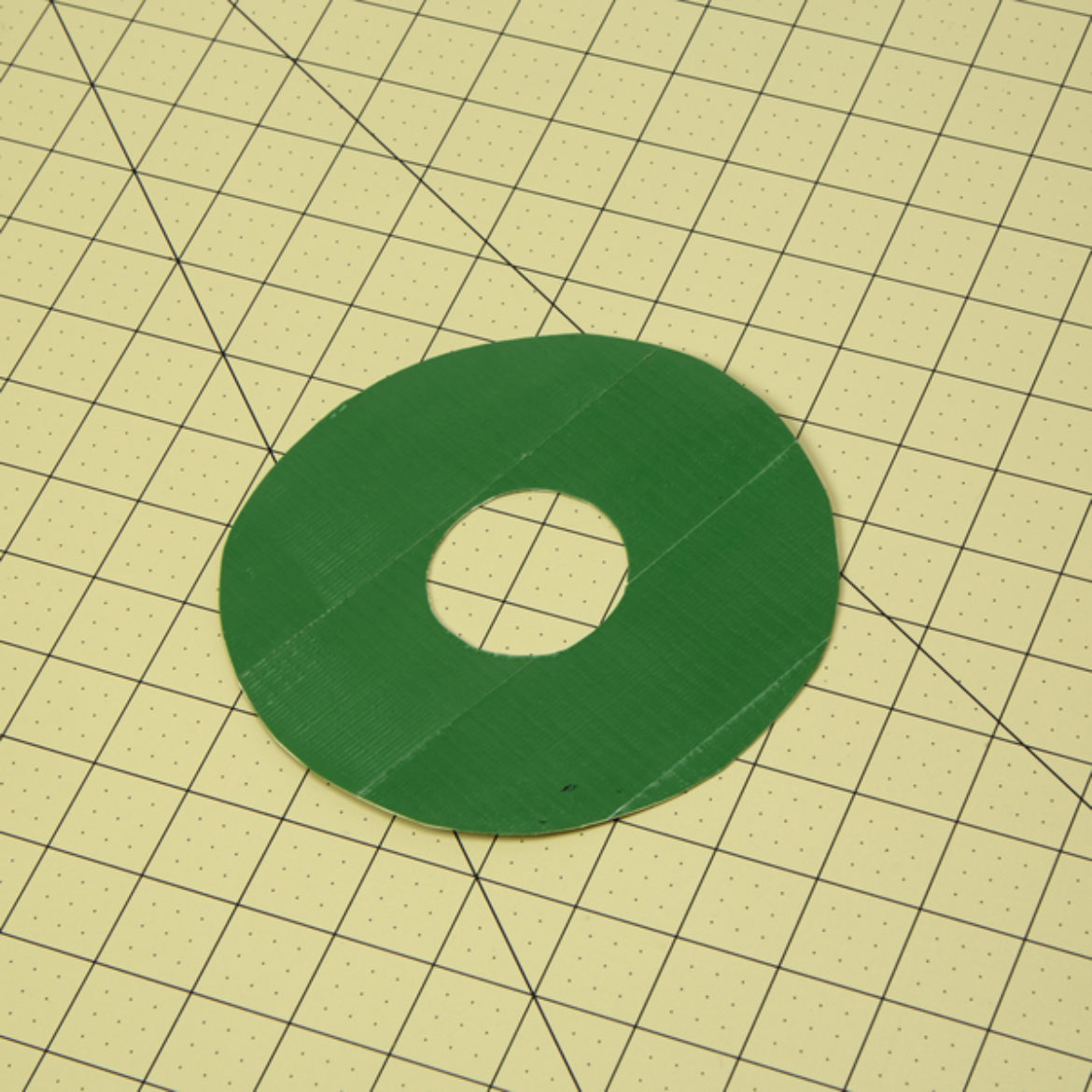 Donut shape from previous step covered in green Duck Tape