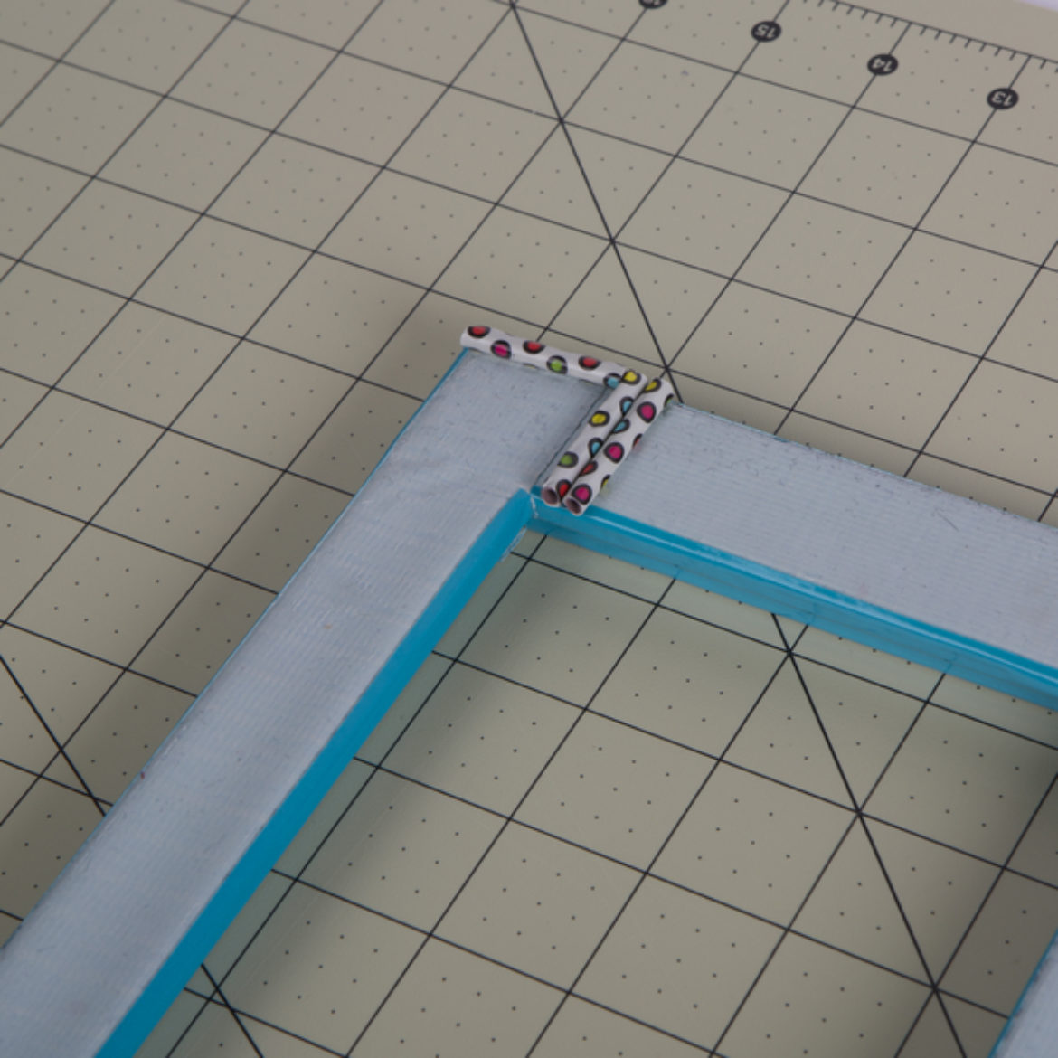 Straw pieces made in step 2 placed on the outward facing tape secured in the previous step