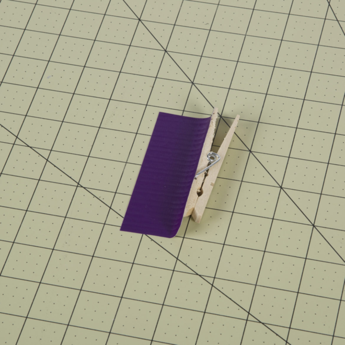 top of a clothes pin covered in purple Color Duck Tape