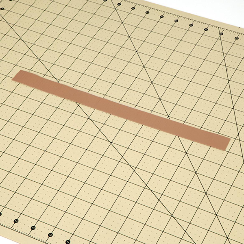 Long strip of Duck Tape folded in half length wise
