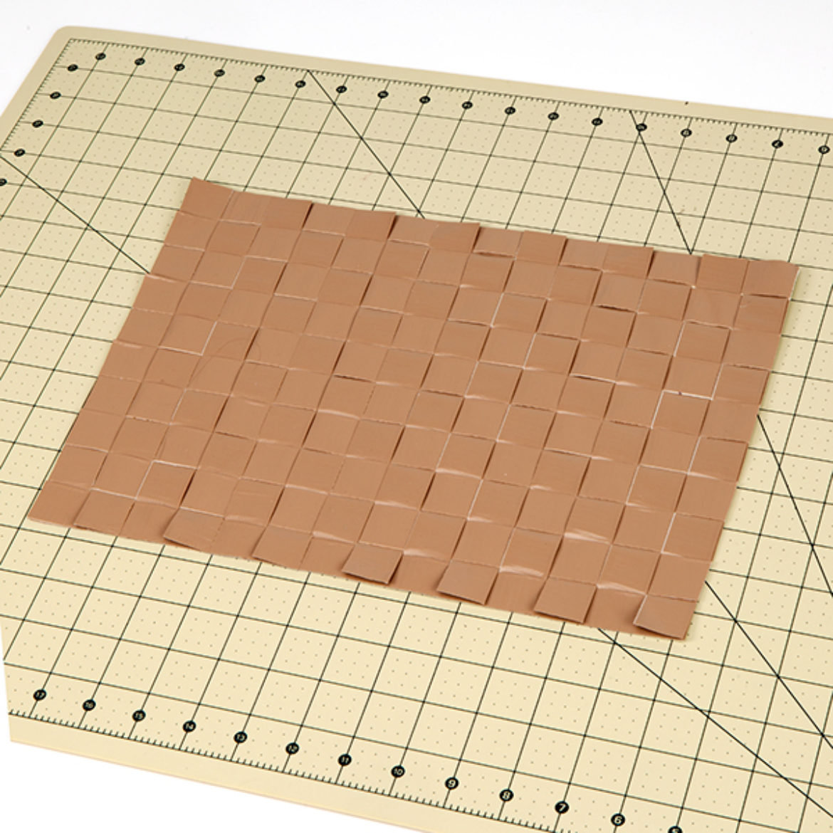 Woven mat laid on top of the sticky sheet
