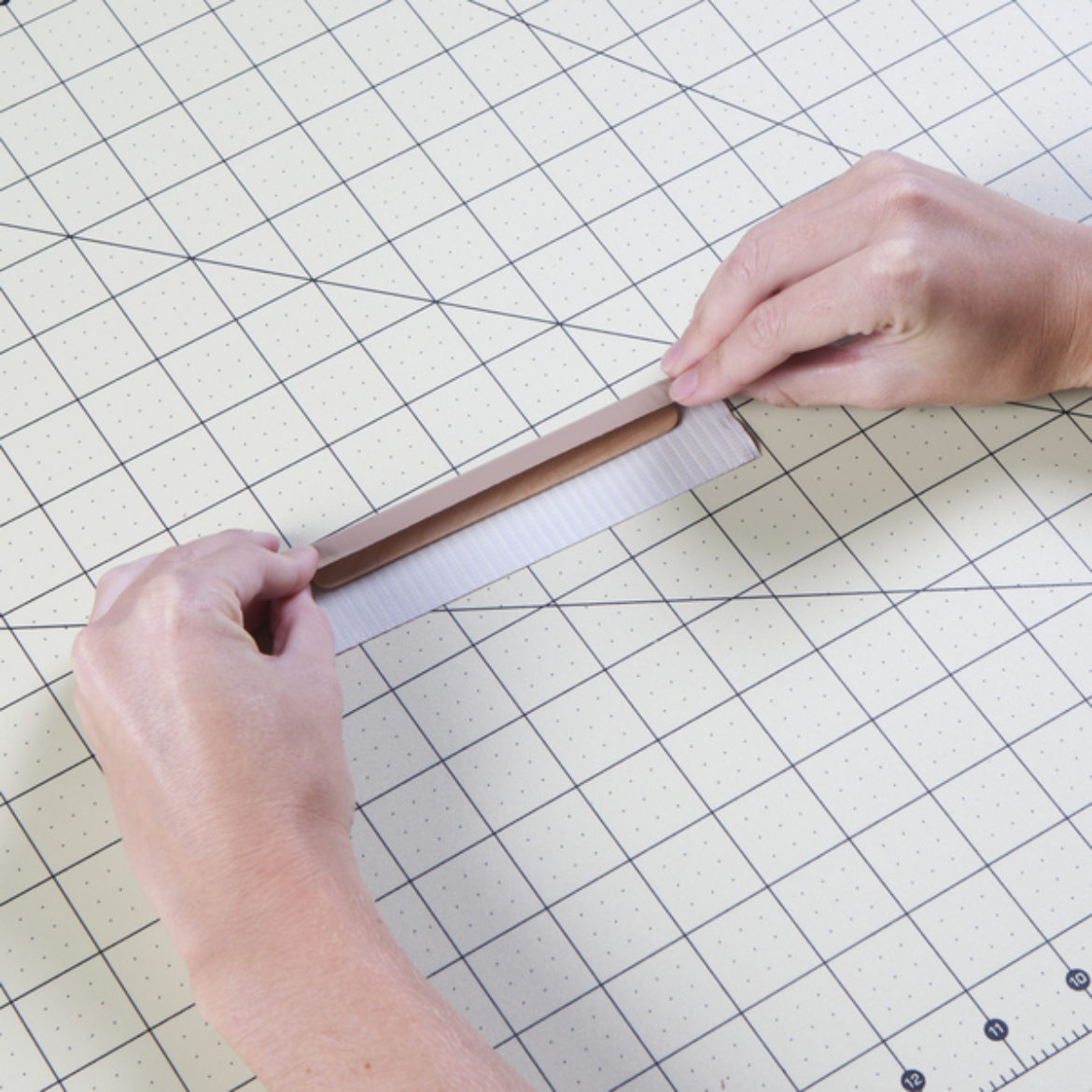 strip of Duck Tape folded over a craft stick so that each end reaches the middle of the stick